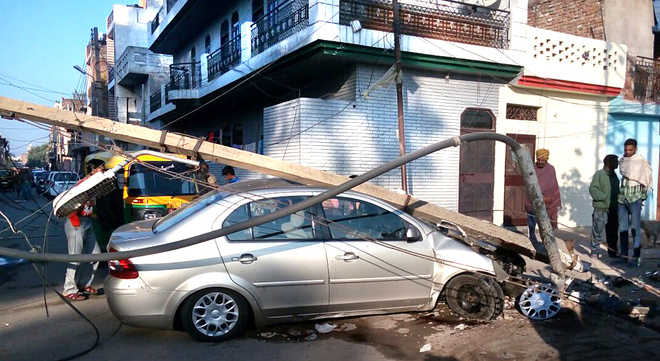 Power Supply Hit As Car Rams Into Pole