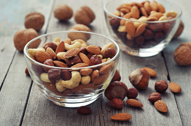 Handful of nuts a day may cut heart disease, cancer risk