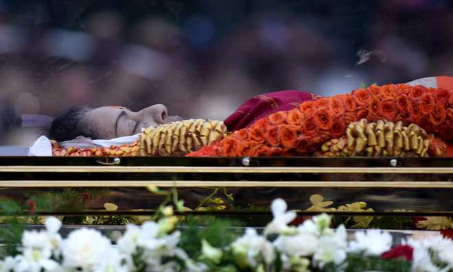 Jayalalithaa laid to rest next to mentor MGR