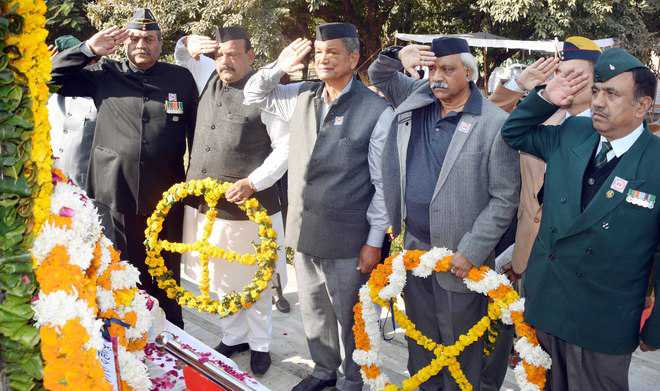 Govt to address grievances of kin of martyrs, says Rawat