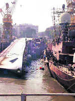 2 dead as warship tips over at dock