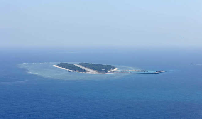US sails warship near Chinese-claimed reef in South China Sea