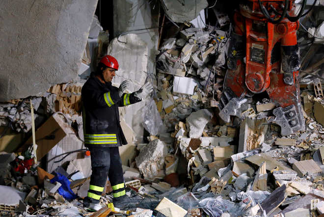 Scores trapped as Italy quake toll reaches 159