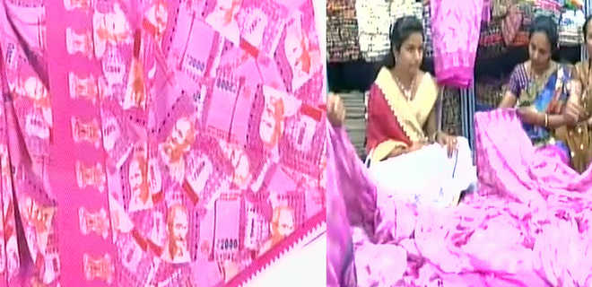 Surat trader comes up with sari with Rs 2,000 notes printed on it
