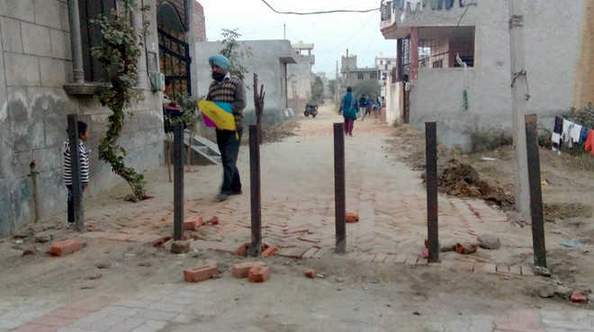 Complaint against ASI for blocking entry in street