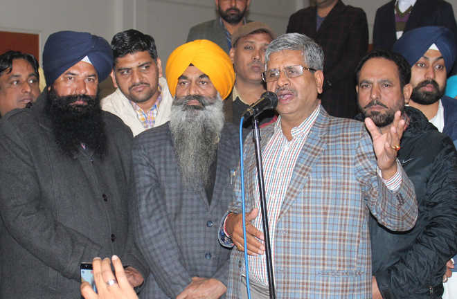 Singla in damage control mode, boosts morale of party workers