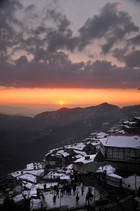 This photo shows a view of a setting sun after heavy snowfall in Shimla on January 10, 2017. Tribune photo:  Amit Kanwar