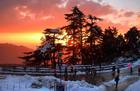 This photo shows a view of a setting sun after heavy snowfall in Shimla on January 10, 2017. PTI photo