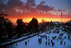 Tourists walk around as the sun sets after heavy snowfall in Shimla on January 10, 2017. PTI photo
