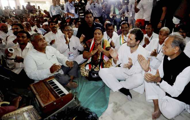 Visiting temples won't get votes, only hard work will: BJP to Rahul