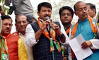 Delhi BJP president Manoj Tiwari with Union Minister Vijay Goel and other party leaders address party workers during their 'Anti-black Money Day' rally to mark the first anniversary of Demonetisation announcement, in New Delhi on Wednesday. PTI