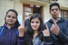 First-time voters show their inked finger after casting votes at a polling station in Shimla on November 9. Tribune photo Amit Kanwar