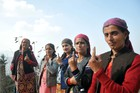 Ladies show their inked finger after casting votes at a polling station at Fagu near Shimla on November 9. Tribune photo: Amit Kanwar