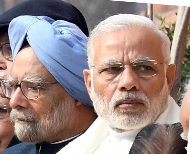 Manmohan: No contest with Modi on 'humble background'