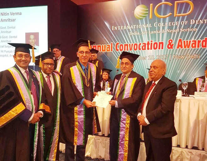 City dentists awarded fellowship