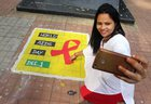 A woman takes a selfie on World Aids Day in Thane on December 1. PTI