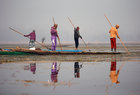 Fishermen use spears to catch fish in the waters of the Anchar Lake on a cold winter day in Srinagar, December 28. Reuters