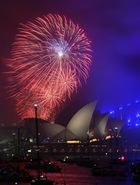 The 'family fireworks', displayed three hours before midnight every year ahead of the main show at midnight, fill the sky over the Opera House and Harbour Bridge in Sydney on New Year's Eve on December 31. AFP