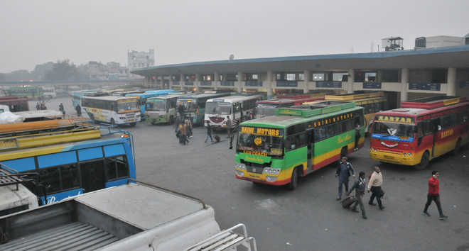 City Bus Stand Fast Turning Into Red Light Area