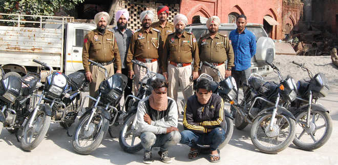 2 arrested with seven stolen motorcycles