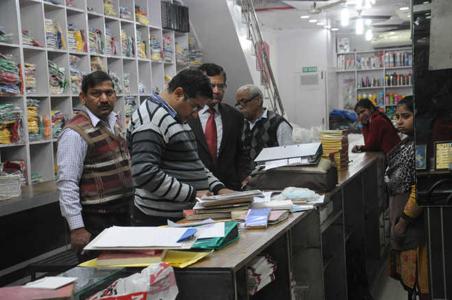 Income tax raids at two shops