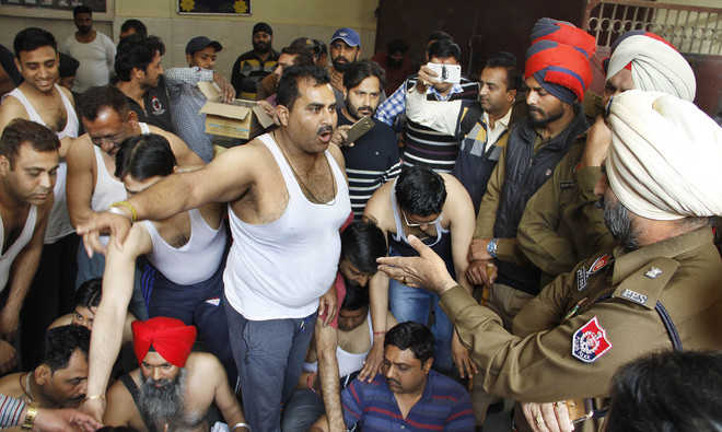 Shirtless, parents protest against school over fee hike