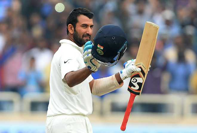 Pujara's double ton puts India at 603-9; Aus 23-2 at stumps on day 4