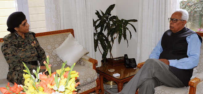 CRPF DIG presents her book to Governor