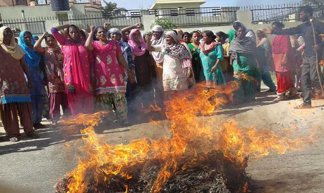 Labour union protests against attack on Dalit woman