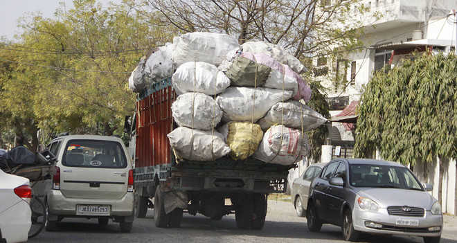 Now, overloaded vehicle claims cop's life