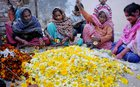 Women make garlands in Amritsar on International Women's Day on March 8, 2017. PTI photo