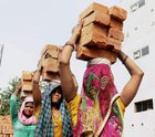 Women carry bricks at a construction site on International Women's Day in Allahabad on March 8, 2017. PTI photo