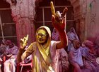 One of the widows dances during Holi celebrations at ancient Gopinath Temple in Vrindavan. PTI