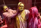Widows playing Holi with colours at ancient Gopinath Temple in Vrindavan. PTI