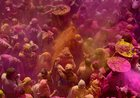 Widows and other devotees playing Holi with colours at ancient Gopinath Temple in Vrindavan. PTI