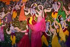 A widow dances in front of the pictures of Lord Krishna and Radha as she celebrates Holi at the ancient Gopinath Temple in Vrindavan. PTI