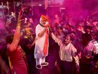 BJP worker play with colours as a giant cut out of Prime Minister Narendra Modi stands in the background as they celebrate the party's victory in the Uttar Pradesh and Uttarakhand Assembly elections at the party headquarters in New Delhi on March 11, 2017. PTI photo
