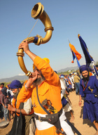 A Sikh devotee blows a horn during the Hola Mohalla festival at Anandpur Sahib on March 13, 2017. Tribune photo: Manoj Mahajan