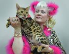 An owner poses with her Bengal cat during the International cat exhibition in Bishkek on March 19, 2017. AFP photo