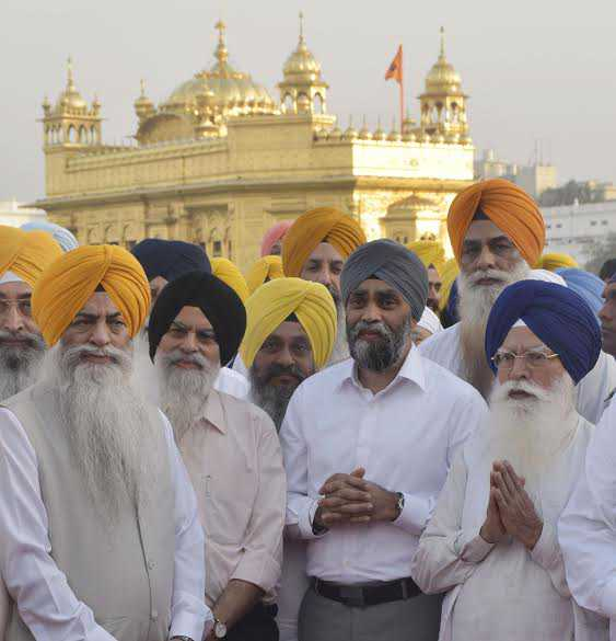 Canadian minister Harjit Singh Sajjan pays obeisance at Golden Temple