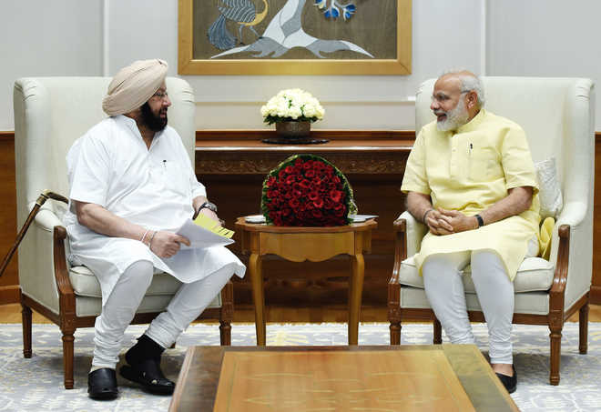 Capt meets Modi, seeks nod to sell power to Pak, Nepal