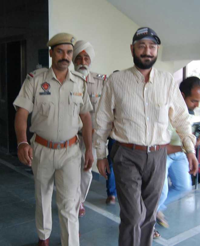 Wanted in rape case, suspended SP gives up