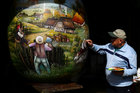 A local artist paints a two-metre-high Easter egg in the traditional naive art style in Koprivnica, Croatia, March 9, 2017. The project, which started ten years ago, involves painters decorating two-metre-tall polyester eggs, which are then sent to cities in the country and abroad to be displayed in public squares in time for Easter festivities. Reuters