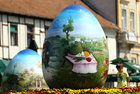 A child looks at a two-metre-high Easter eggs painted in the traditional naive art style in Koprivnica, Croatia, April 9. Reuters