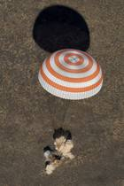 Russia's Soyuz MS-02 space capsule carrying the International Space Station (ISS) crew members, NASA astronaut Shane Kimbrough and cosmonauts Sergey Ryzhikov and Andrey Borisenko of the Russian space agency Roscosmos, lands in a remote area outside the town of Dzhezkazgan (Zhezkazgan), Kazakhstan, on April 10, 2017. Reuters photo