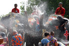 Elephants spray tourists with water in celebration of the Songkran Water Festival in Ayutthaya province, north of Bangkok, Thailand, on April 11, 2017. Reuters photo