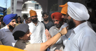 Advocates and representatives of the students arguing with police at main entrance of gurdwara at Panjab University in Chandigarh on April 11. Tribune photo: S Chandan