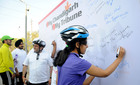Participants of the 'Cylothon' 2017 organised by The Tribune write messages on a board after the rally. Tribune photo: Pradeep Tiwari