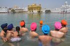 Sikh devotees take a dip in the holy sarovar (water tank) on the occasion of Baisakhi at the Golden Temple in Amritsar on April 13, 2017. AFP photo