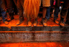 The feet of devotees are seen covered with vermillion powder during the 'Sindoor Jatra' vermillion powder festival at Thimi, in Bhaktapur, Nepal April 15, 2017. Reuters